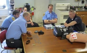 Clinical Coordinator, Matt Brennan, demonstrating the new features of the Zoll X Series to staff at Station 1.